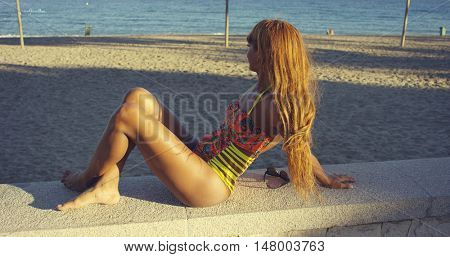 Young woman relaxing at the seaside