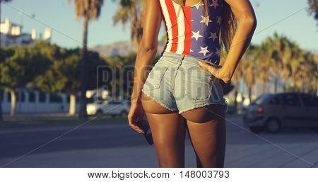 Rear View of Woman Wearing Sexy Denim Shorts