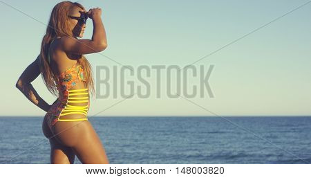 Attractive Woman in Swimsuit Looking Far Away