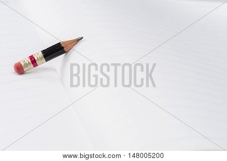 Black Pencil With Pink Eraser On A Paper