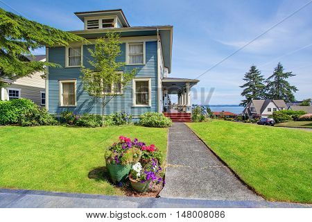 Classic Large Craftsman Old American House Exterior In Blue Tones With Well Kept Garden