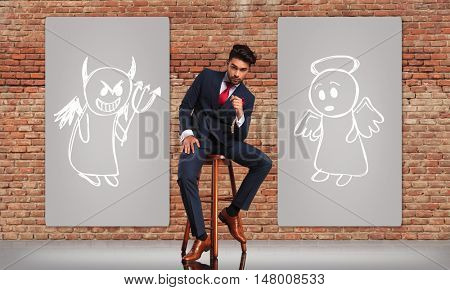 young business man in double breasted suit making a decision between good or bad