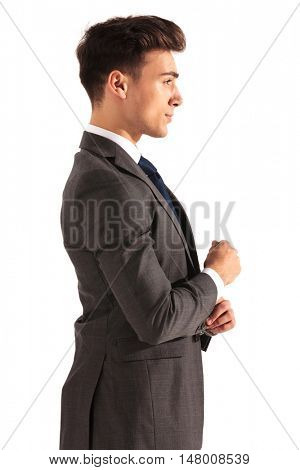 profile picture of a young business man fixing his sleeve on white background