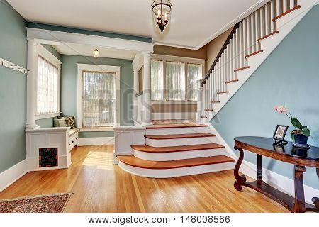 Hallway Interior In Blue Tones, Columns And Hardwood Floor. View Of Stairs.