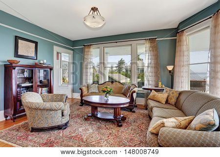 Traditional Living Room Interior In Blue And White Tones. Also Many Windows