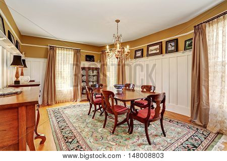 Traditional Dining Room Interior With Antique Furniture And Rug.