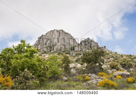 Views of Pico de la Miel (Honey Peak). It is a granite batholith located at  Sierra de la Cabrera, Madrid, Spain