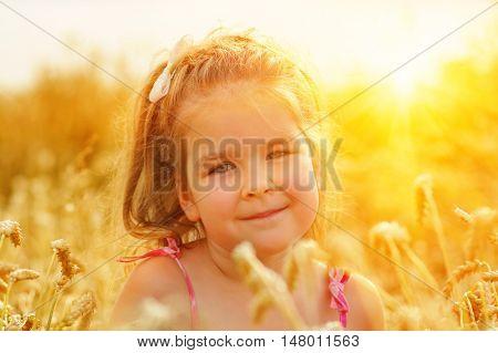 Girl on a wheat field