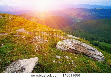 Mountain landscape with the sun