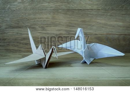 Origami Crane On A Wooden  Background