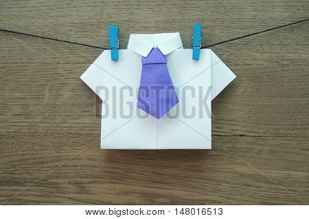 origami shirt on wooden background close-up .