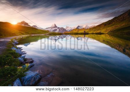 Panorama of Mt. Schreckhorn and Wetterhorn above Bachalpsee lake. Dramatic and picturesque scene. Location place Swiss alps, Bernese Oberland, Grindelwald, Europe. Soft filter effect. Beauty world.