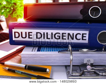 Due Diligence - Blue Office Folder on Background of Working Table with Stationery and Laptop. Due Diligence Business Concept on Blurred Background. Due Diligence Toned Image. 3D.