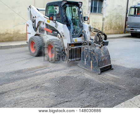 worker driver Skid steer remove Worn Asphalt during repairing Road Works