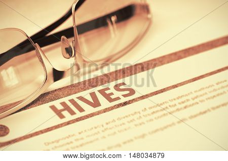 Hives - Medical Concept with Blurred Text and Spectacles on Red Background. Selective Focus. Hives - Medical Concept on Red Background with Blurred Text and Composition of Eyeglasses. 3D Rendering.