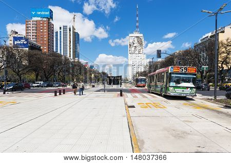 Buenos Aires Argentina - October 4 2013: View of the Avenida 9 de Julio in the city of Buenos Aires with buses and people in the street.