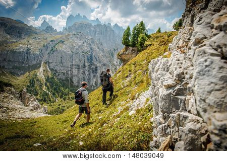 Dolomites Trail Hikers. Father and Son on the Scenic Alpine Trail. South Tyrol Dolomites Italy Europe.