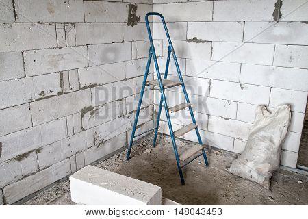 Stepladder in the corner during capital repair