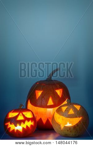 two halloween pumpkin on blue background