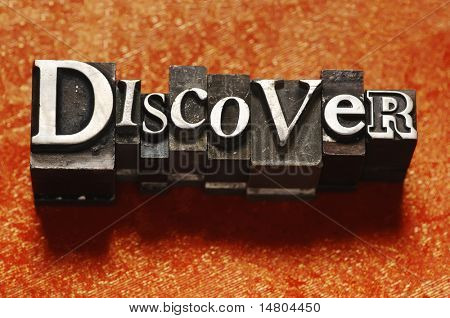 """The word """"Discover"""" done in old lead type."""