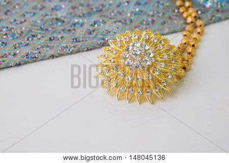 Shiny Gold Jewelry On White Background