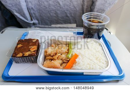 Meal serve on airplane with bakery and soft drink