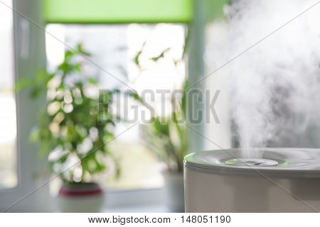 Vapor from humidifier in the morning light in a living room poster