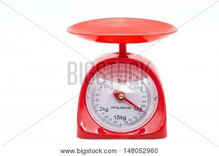 red kitchen weighting scale point at one kilogram isolated white background .