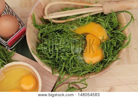 Egg and vegetables acacia pennata for omelet cooking