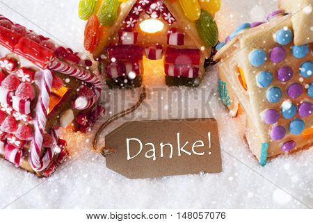 Label With German Text Danke Means Thank You. Colorful Gingerbread House On Snow And Snowflakes. Christmas Card For Seasons Greetings