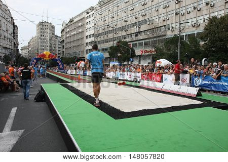 BELGRADESERBIA - SEPTEMBER 11 2016:Preparation of long jump runway for competition as promotion of European athletics indoors championship which will be held from 3-5.March 2017 in BelgradeSerbia