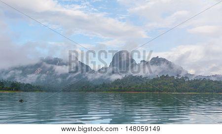 Beautiful view of water and mountain at Ratchaprapha dam Surat Thani Thailand.