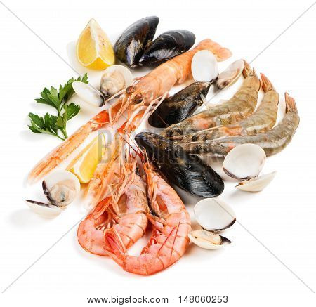 Uncooked seafood (langoustine shrimp shellfish mussel clam) decorated with lemon and parsley isolated on white background.