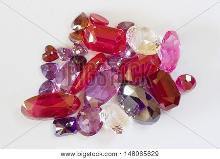 semi-precious faceted stones on a white background
