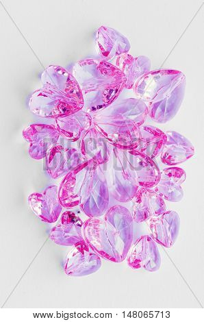 pink plastic hearts on a black background