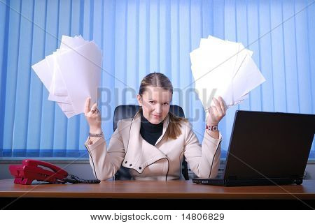 .young businesswoman holding documents