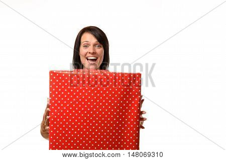 Happy Overjoyed Woman Holding A Large Red Gift