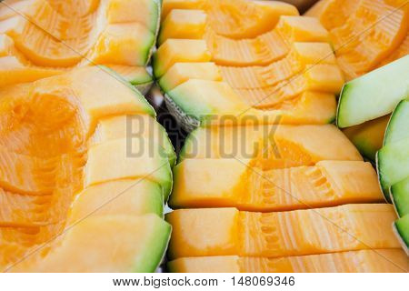 Melon or cantaloupe sliced (Also called as cantelope cantaloup muskmelon mushmelon rockmelon sweet melon Persian melon spanspek)