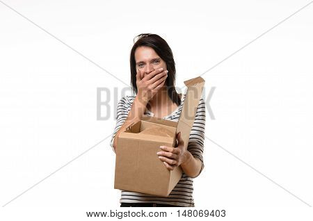 Woman With Hand On Mouth While Holding Box
