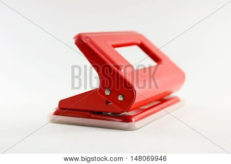 Red puncher on white background isolated closeup.
