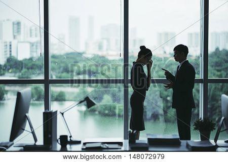 Sulhouette of boss scolding shameful female employee