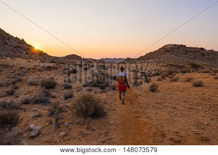 Tourist Walking In The Namib Desert At Sunset, Namib Naukluft National Park, Namibia. Adventure And