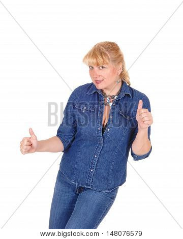 A lovely woman in jeans and jeans jacket standing isolated for white background gesturing with her hands thumps up.