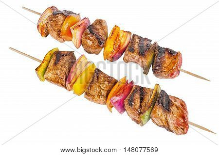 Skewer set of red meat and vegetables isolated on white background.