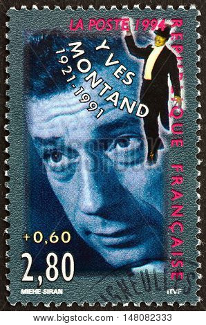 FRANCE - CIRCA 1994: a stamp printed in France shows Yves Montand Italian-French Actor and Singer circa 1994