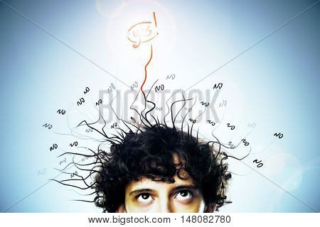 Portrait of young man with messy hair who found the solution on blue background. Idea concept