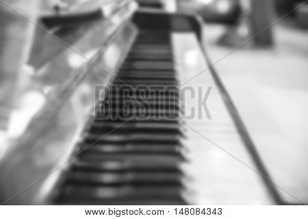blurred piano in a music store black and white tone