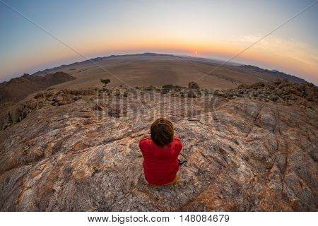 Tourist Watching The Stunning View Of Barren Valley In The Namib Desert, Among The Most Important Tr