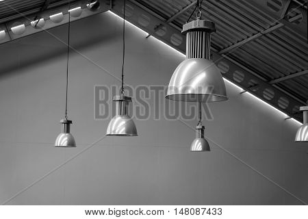 Big lamp silver on ceiling factory black and white tone