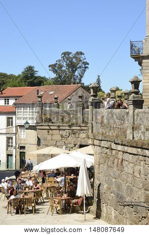 SANTIAGO DE COMPOSTELA, SPAIN - AUGUST 5, 2016: Some people at outdoor bar in the old part of the city in Santiago de Compostela Galicia Spain